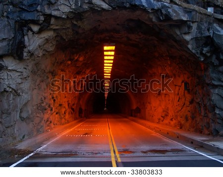 Closeup of an illuminated tunnel at entrance of Yosemite National Park - stock photo