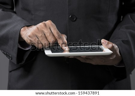 Closeup of an Indian man with a tablet computer. Asian business man using digital tablet computer.