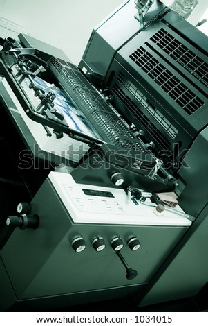 Closeup of an Offset Printing Machine in print shop - stock photo