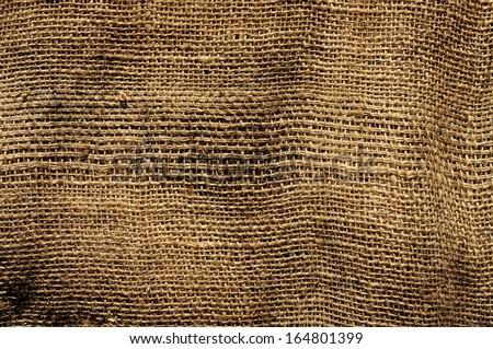 closeup of an old and dirty burlap fabric - stock photo