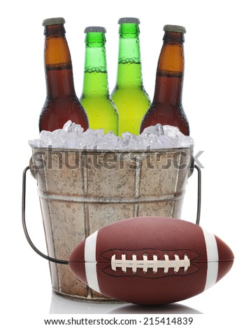 Closeup of an old fashioned beer bucket with three green bottles of cold beer and an American Football. Isolated on white with reflection. - stock photo