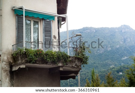 closeup of an old Italian balcony covered with plants