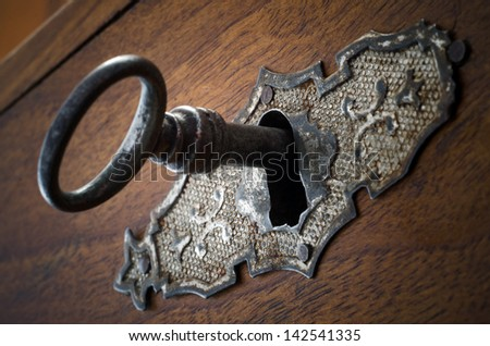 Closeup of an old lock with metallic trim - stock photo