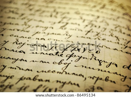 Closeup of an old manuscript written with ink - stock photo