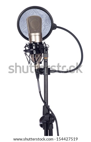 Closeup of an old microphone on a white background - stock photo