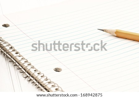 Closeup of an Old Notebook of Paper with a Pencil on the side.  Horizontal with room or space for your words, text or copy.  Modern look or treatment - stock photo