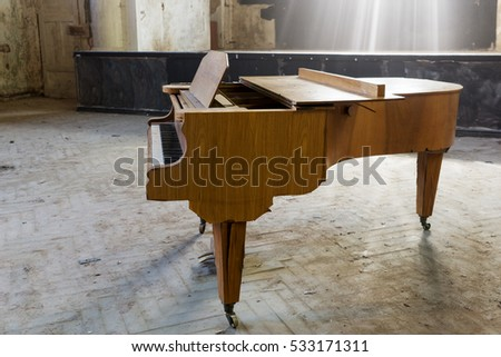 closeup of an old piano in an auditorium