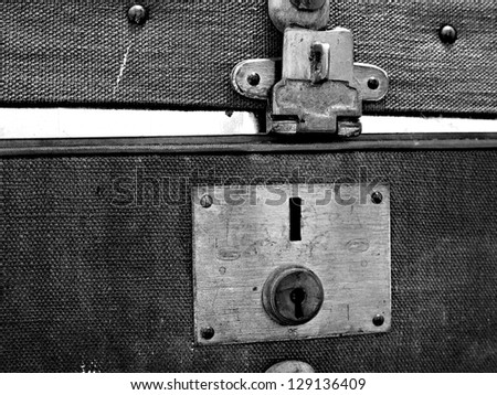 Closeup of an old suitcase. - stock photo