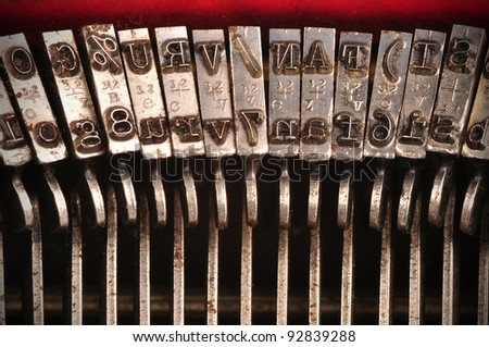 Closeup of an old typewriter's characters - stock photo