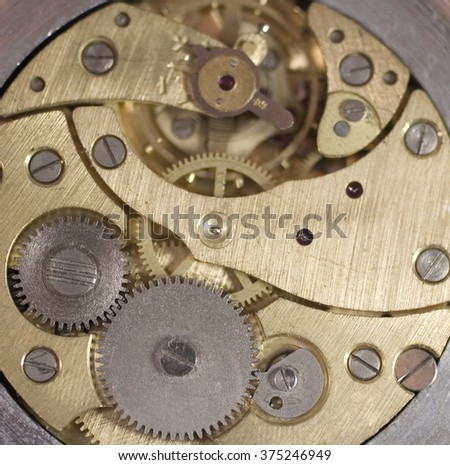 Closeup of an old watch mechanism (as a background, shallow DOF)
