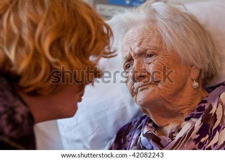 Closeup of an old woman with her granddaughter - stock photo