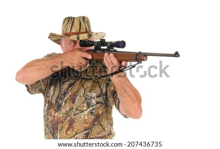 Closeup of an older hunter taking aim on his target, illustrating the correct position for trigger finger until ready to shoot - stock photo
