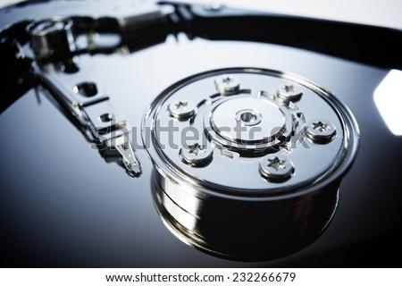 Closeup of an open computer hard drive - stock photo