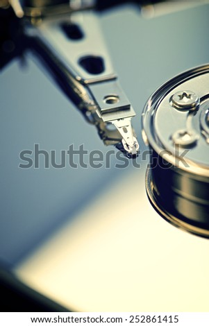 Closeup of an open computer hard drive - stock photo