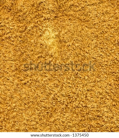 Closeup of an orange hand towel - stock photo