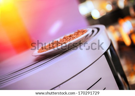 closeup of an pellet stove with wood pellets on top - stock photo