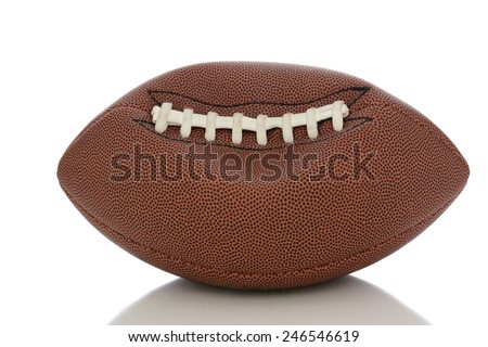 Closeup of an Professional American style football partially deflated on white with reflection. - stock photo