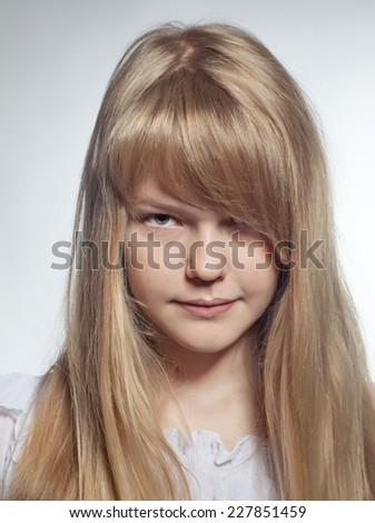 Closeup of angry young girl  - stock photo