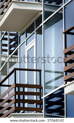 Closeup of apartment building with balconies - stock photo
