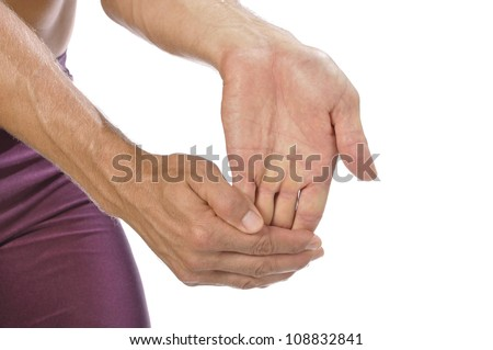 Closeup of athletic man stretching his hand, wrist, and forearm on white background