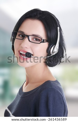 Closeup of attractive customer support representative smiling - stock photo