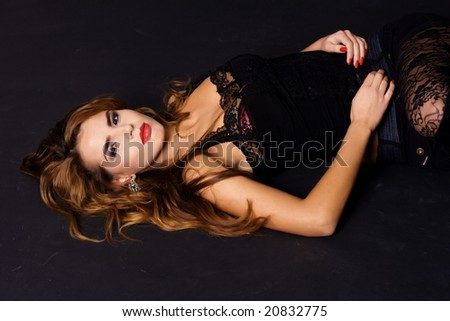 Closeup of attractive woman lying on floor
