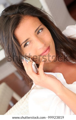 Closeup of attractive woman talking on mobile phone