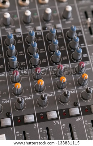 Closeup of audio mixer with filter knobs and selective focus - stock photo