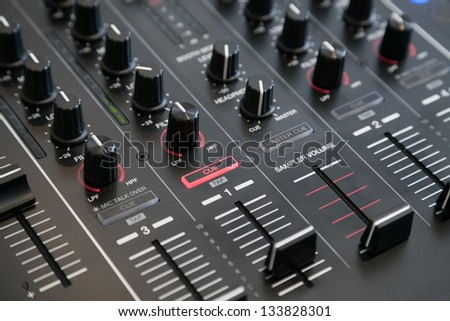 Closeup of audio mixer with selective focus - stock photo