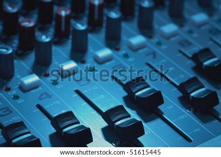 Closeup of audio mixing board focus of fader knob - stock photo