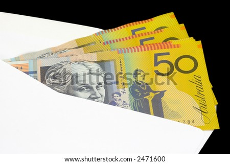 Closeup of Australian currency in envelope on black background