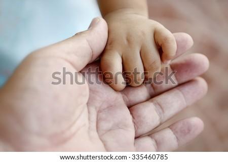 Closeup of baby hand - stock photo