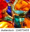 Closeup of back lit stained abstract glass pattern - stock photo
