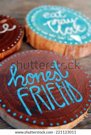 closeup of Badges with words, honest friend, eat pray love - stock photo