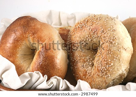 Closeup of bagels in a basket against a white background