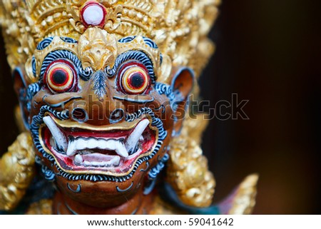Closeup of Balinese God statue in temple complex - stock photo