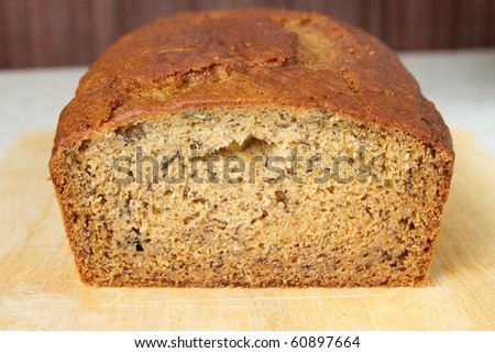 closeup of banana bread on a cutting board in the kitchen - stock photo