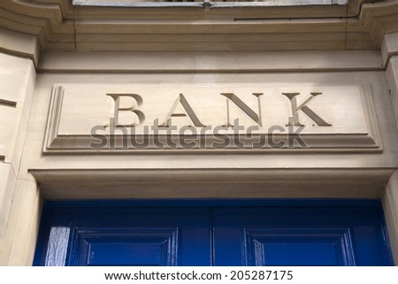 Closeup of Bank Sign on Yellow Stone Background