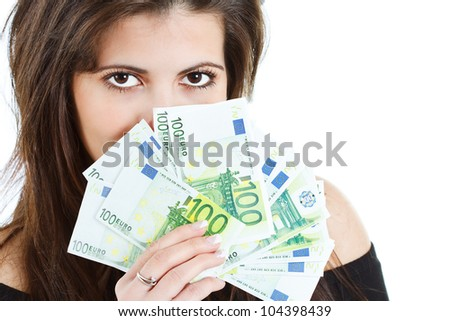 Closeup of banknotes - euros - held by a beautiful young woman with long brown hair, hiding behind the money, big brown eyes seen - isolated on white - stock photo