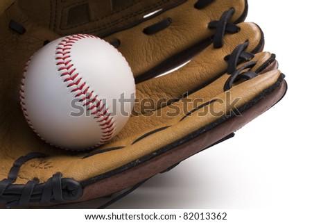 Closeup of baseball glove holding baseball on white background. - stock photo