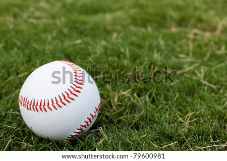 Closeup of baseball on grass with copy space. - stock photo