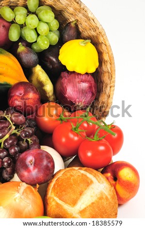 Closeup of basket spilling over with autumnal bounty - stock photo