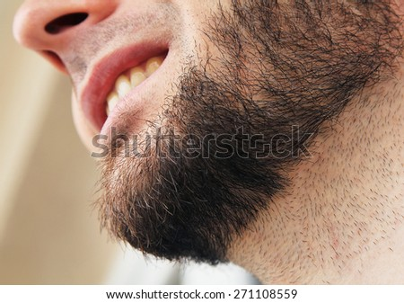 Closeup of beard man smiling