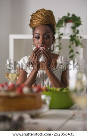 Closeup Of Beautiful African American Woman Eating Healthy Food and Drinking Wine At Home - stock photo