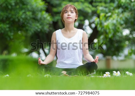 Closeup of beautiful asian women doing yoga in park