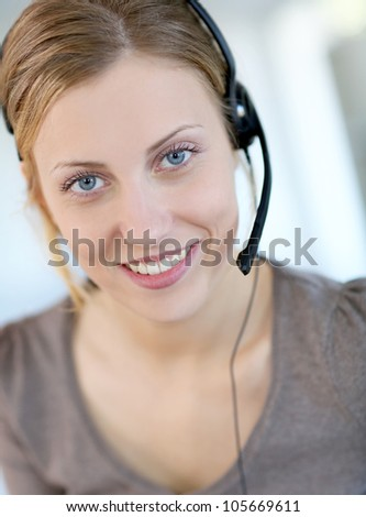 Closeup of beautiful blond teleoperator - stock photo