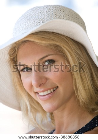 Closeup of beautiful blonde lady smiling