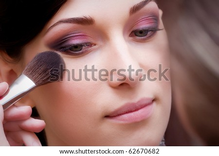 closeup of beautiful brunette young lady profile prepared for the wedding event - stock photo