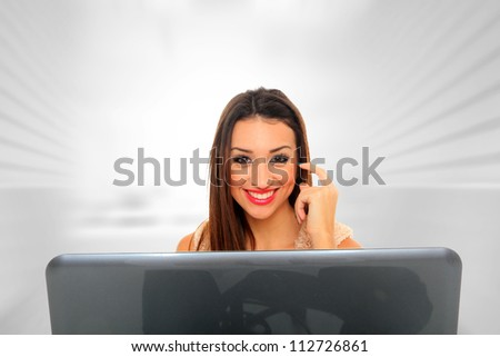 Closeup of beautiful business woman using laptop computer - stock photo