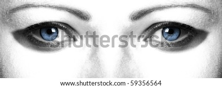 Closeup of beautiful eyes - stock photo